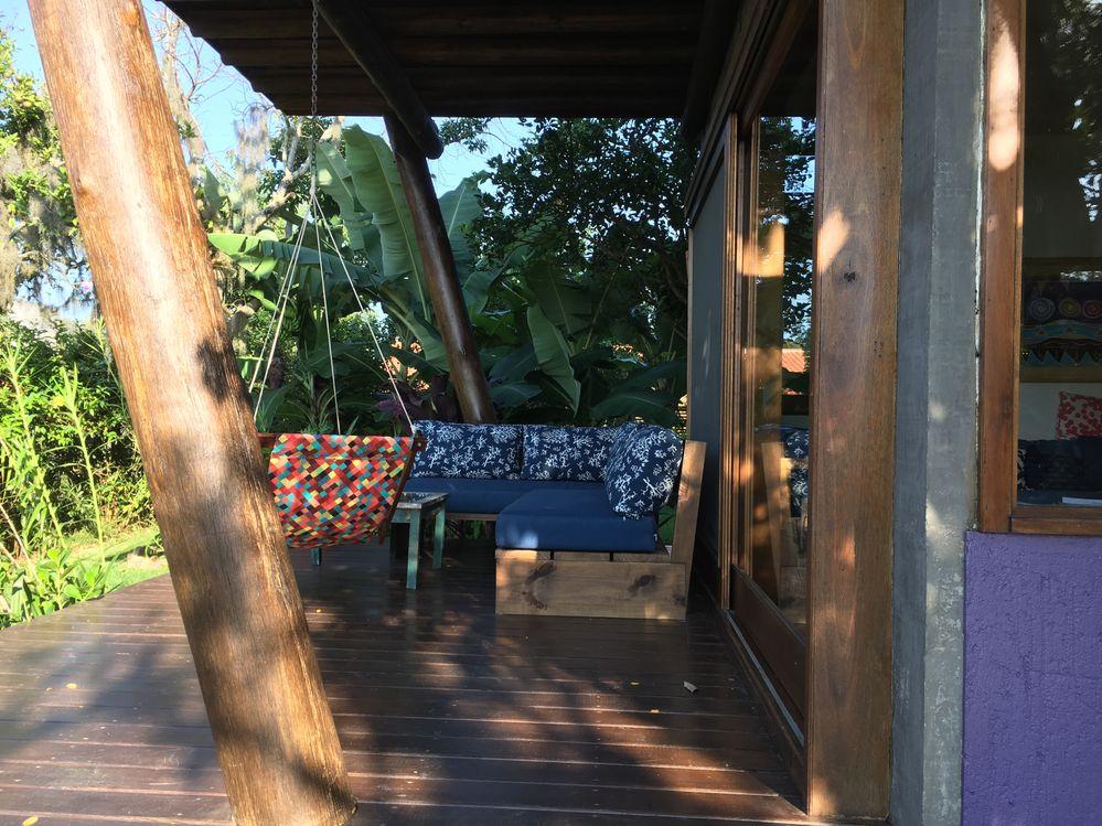 Sofá do deck e cadeira de balanço