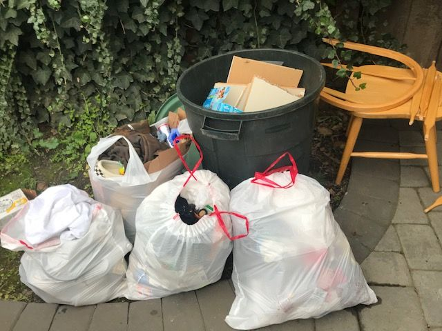 Collected trash and damaged furniture