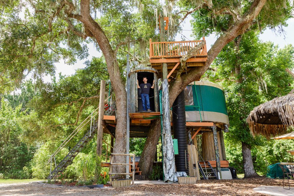 Author Joseph Michelli explores the treehouse at Danville, a collection of Airbnb listings in Geneva, Florida. Photo credit: Steven Miller Photography, Steven Miller