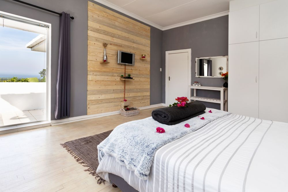 From plain white walls to a rich dark grey with natural wood on the wall.