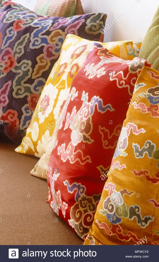 brightly-coloured-patterned-cushions-in-a-row-MFWCY2.jpg